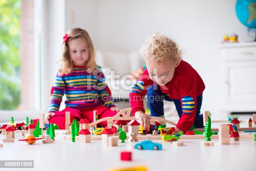 istock Children playing with toy railroad and train 496661956