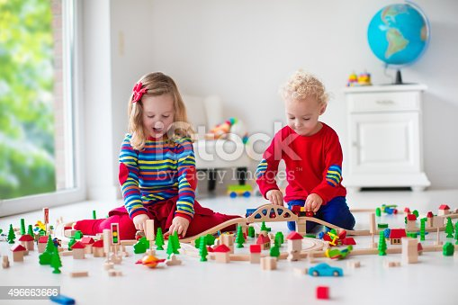 istock Children playing with toy railroad and train 496663666