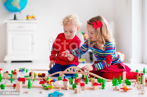 istock Children playing with toy railroad and train 518814948