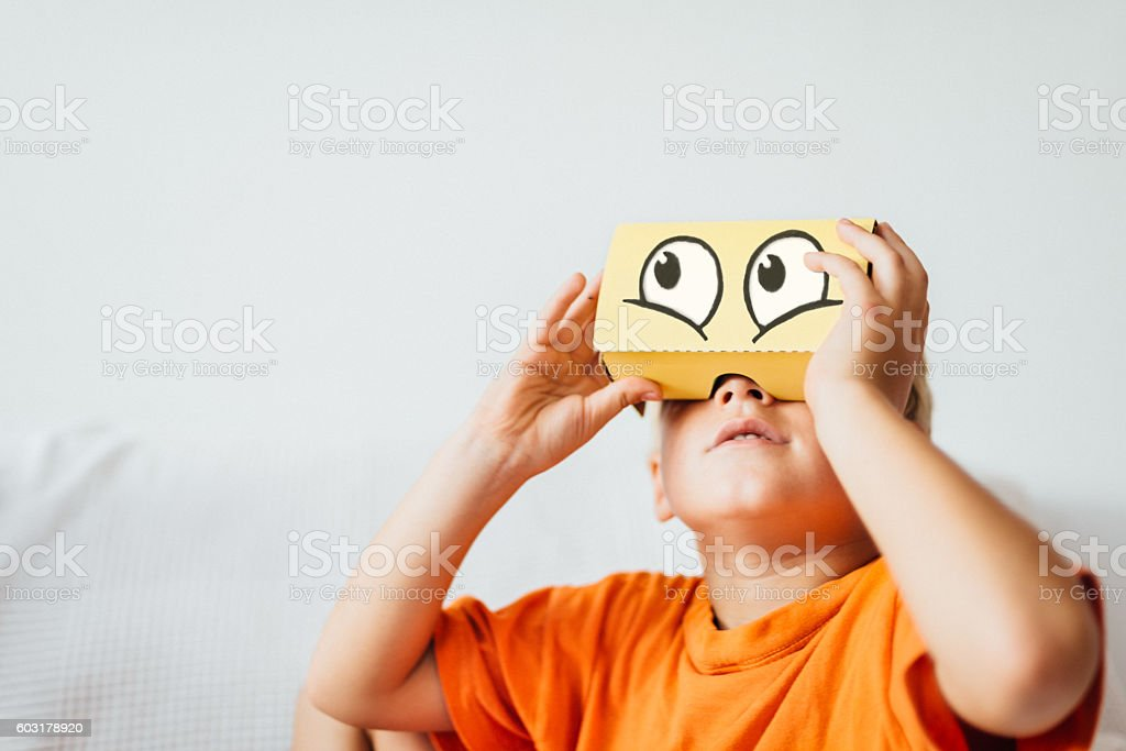 Children playing with Virtual Reality Headsets stock photo
