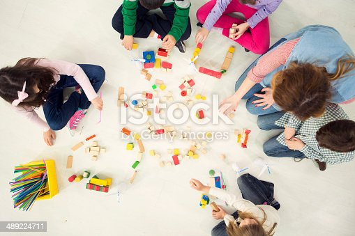 544351868 istock photo Children Playing With Wooden Blocks in the kindergarden. 489224711