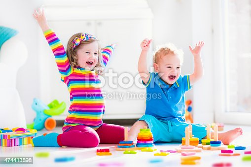 istock Children playing with wooden toys 474413898