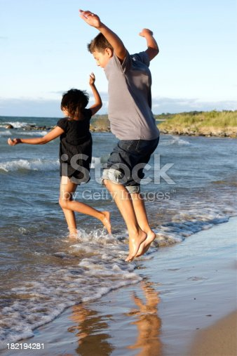509813720 istock photo Children Plying at the Beach 182194281