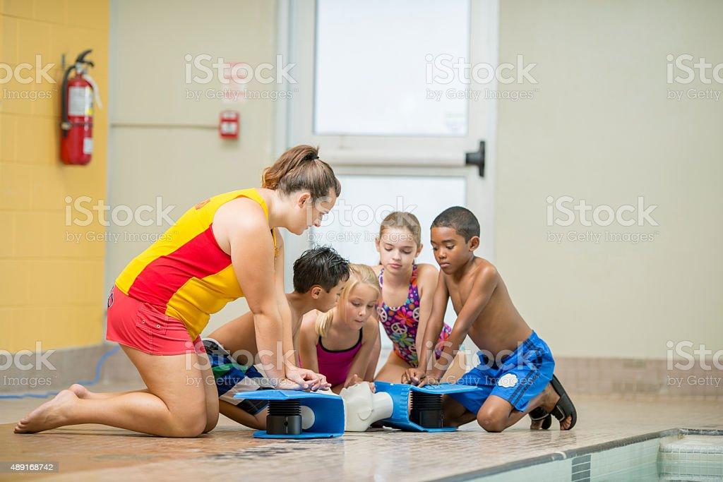 Children Practicing CPR stock photo