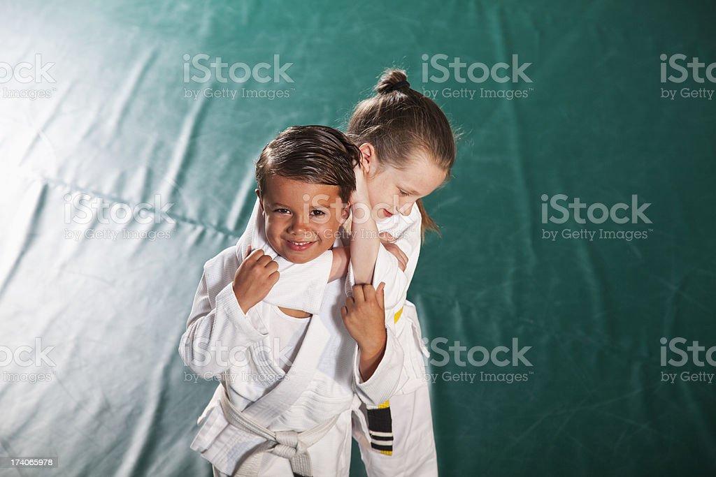 Children practicing Jiu-Jitsu chokehold stock photo