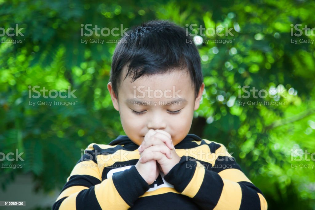 Children pray to God. stock photo