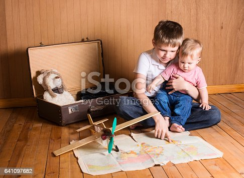 istock Children preparing for the journey. Brother and baby sister. Traveling. 641097682