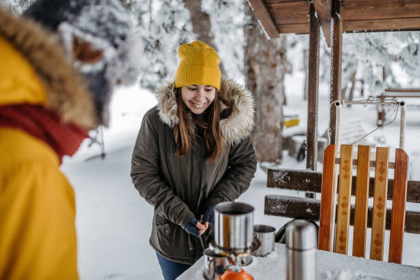Children preparing tea in winter outdoors Children preparing tea in winter outdoors. 12 17 months stock pictures, royalty-free photos & images