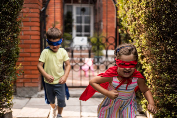 Children pretending to be superheroes stock photo