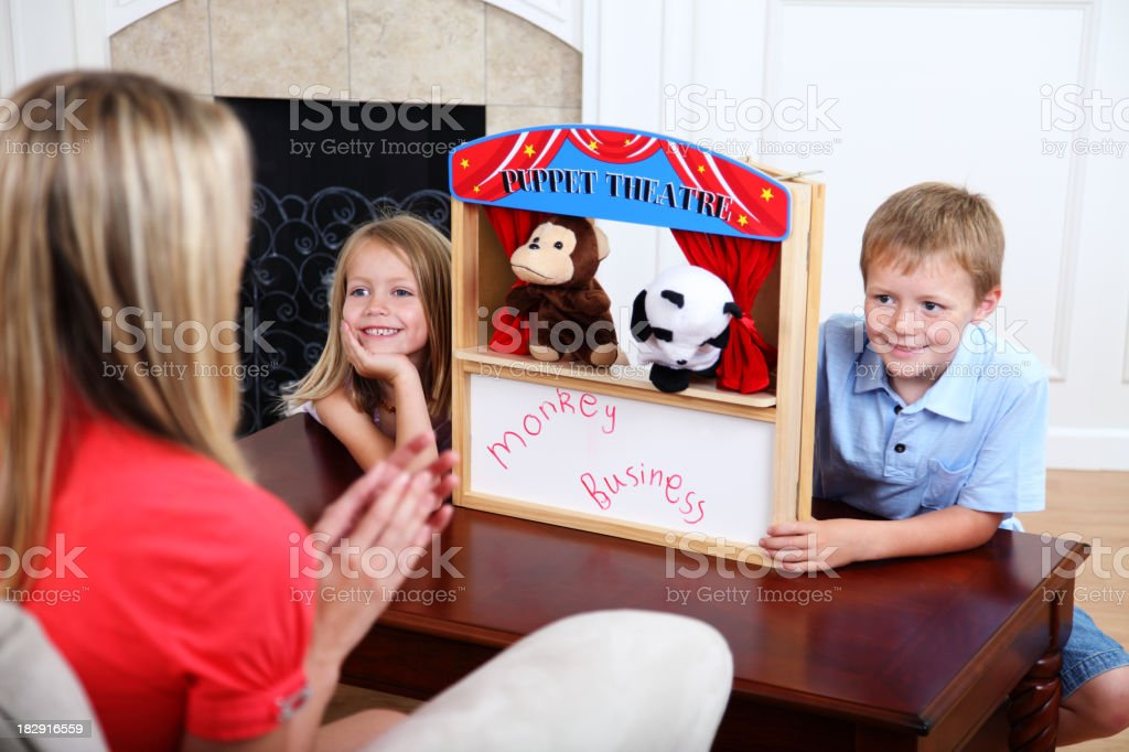 Children Putting On Puppet Show stock photo