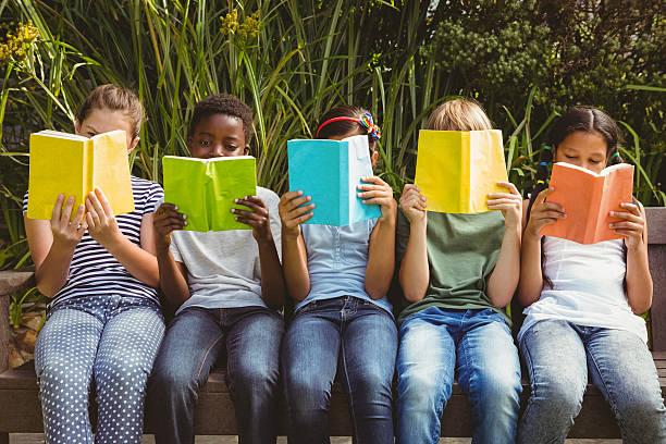Children reading books at park picture id474967010?b=1&k=6&m=474967010&s=612x612&w=0&h=vcejwe63y0oowv1jlmlb88ya9gcaw5fc ce8wahxsk0=