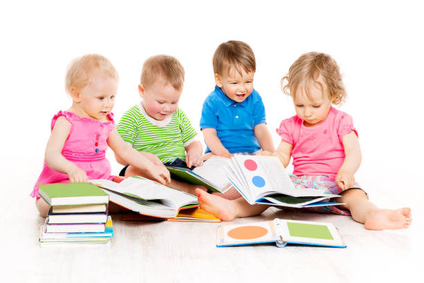 Children Reading Books, Babies Early Education, Kids Boys and Girls White Isolated stock photo