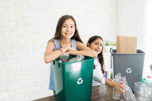 children recycling at home - earth day stock pictures, royalty-free photos & images