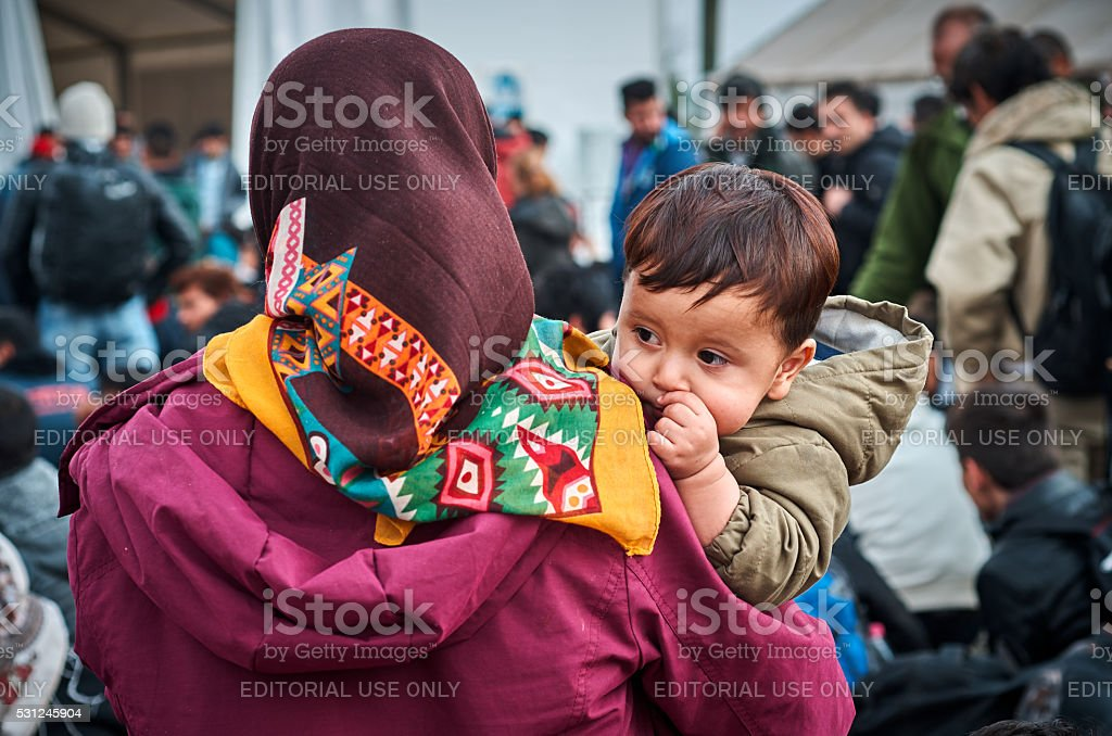 Children refugees Gevgelija, Macedonia, Republic of - October 28, 2015: waiting and hoping for the better future Displaced Persons Camp Stock Photo
