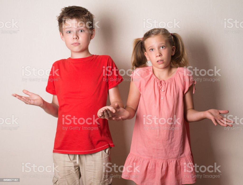 Children rejecting the responsibility denying mistake with not me gesture. stock photo