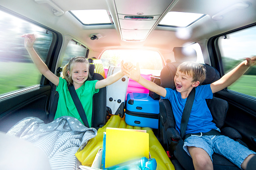 Children Relax In The Car During A Long Car Journey Stock Photo - Download Image Now
