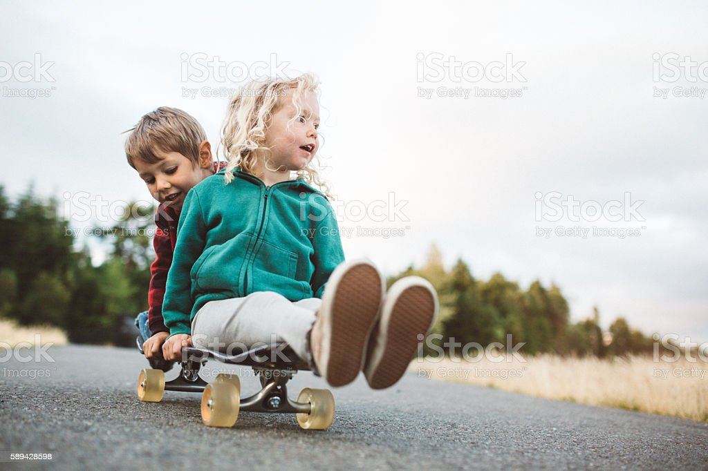Children Riding on Skateboard stock photo