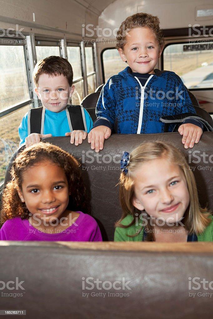 Children riding school bus stock photo