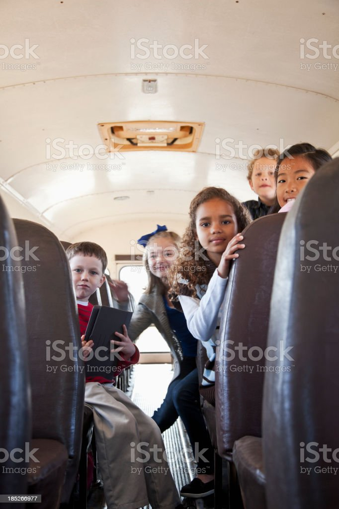 Children riding school bus royalty-free stock photo