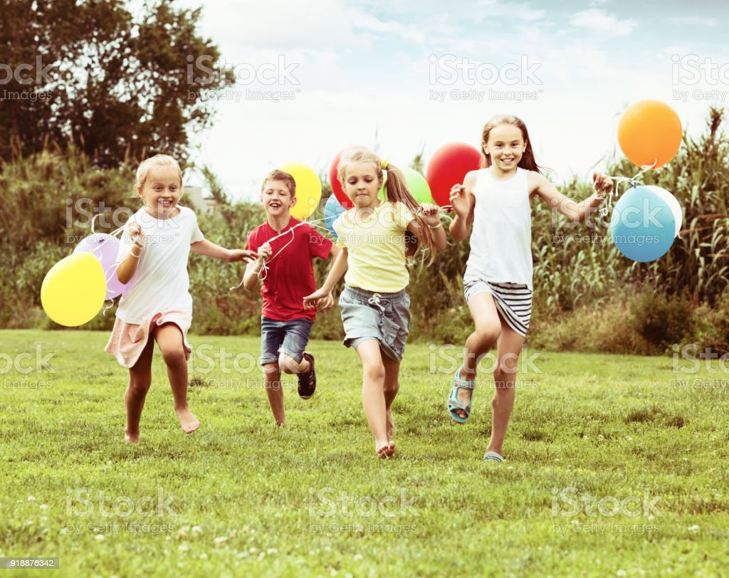 https://media.istockphoto.com/photos/children-running-and-holding-balloons-picture-id918876342