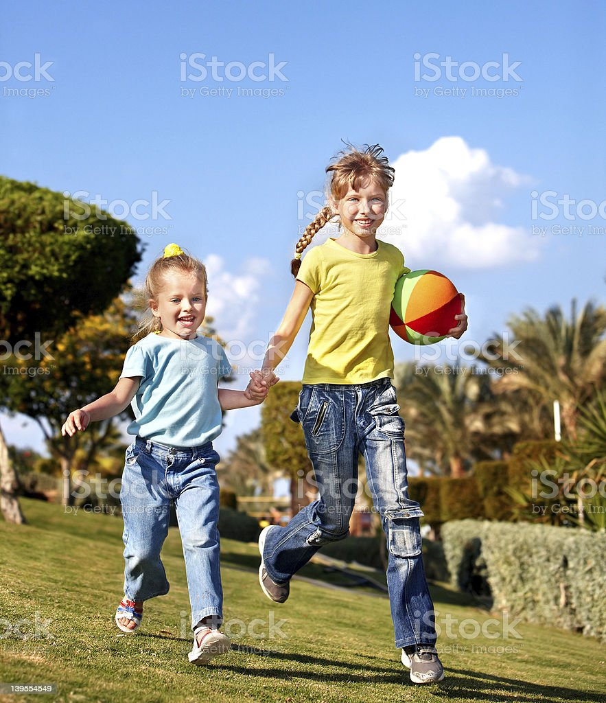 Children running in park. royalty-free stock photo