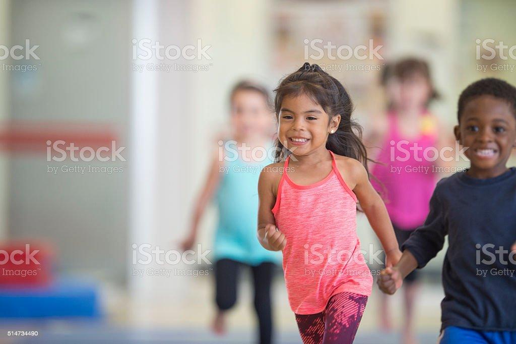 Children Running in the Gym stock photo