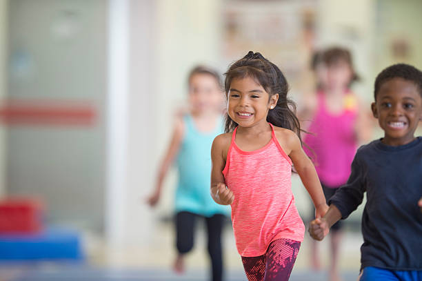 Children Running in the Gym stock photo