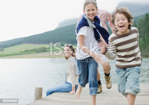 istock Children running on pier by lake 88688880