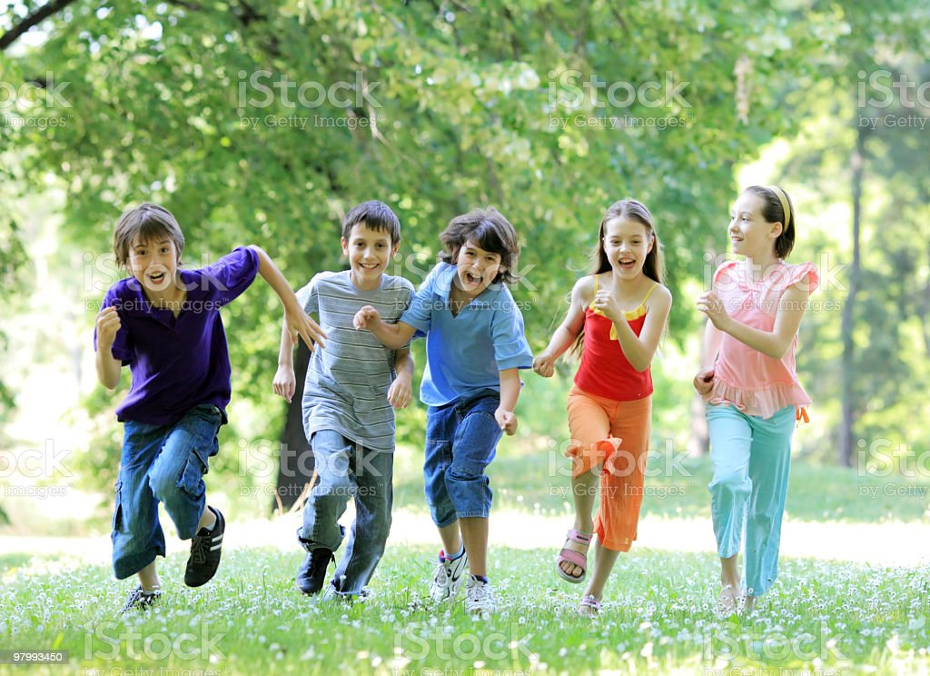 Children running outdoor. royalty free stockfoto