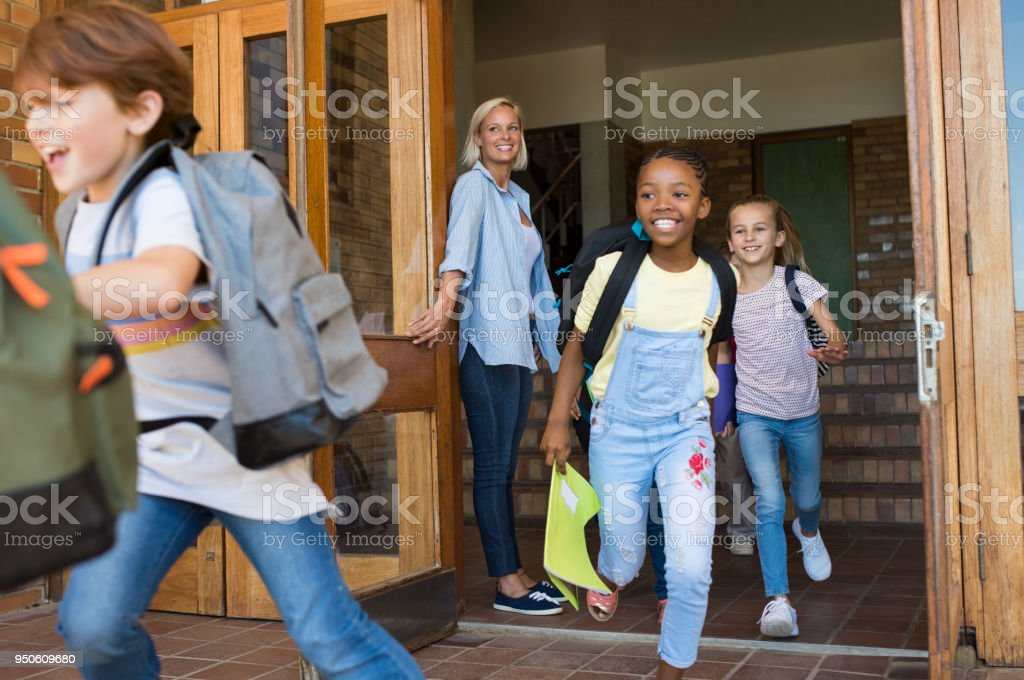 Children running outside school royalty-free stock photo