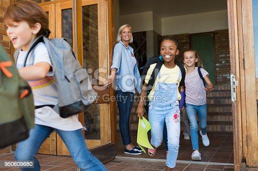 istock Children running outside school 950609680