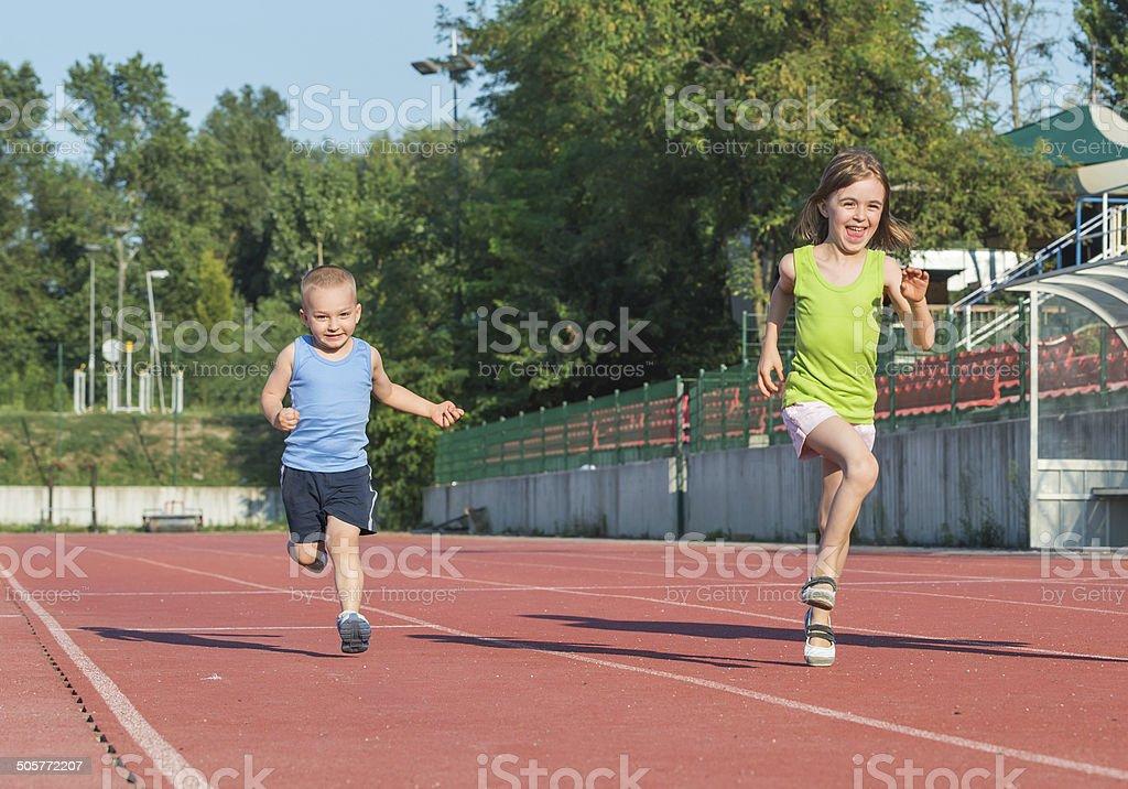 children running stock photo