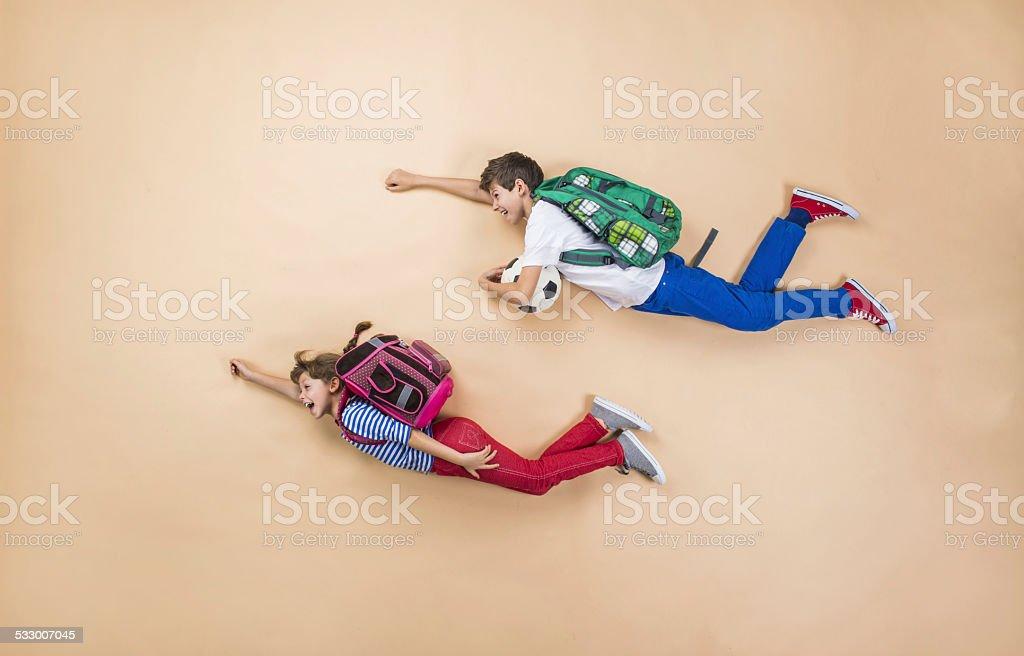 Children running to school stock photo