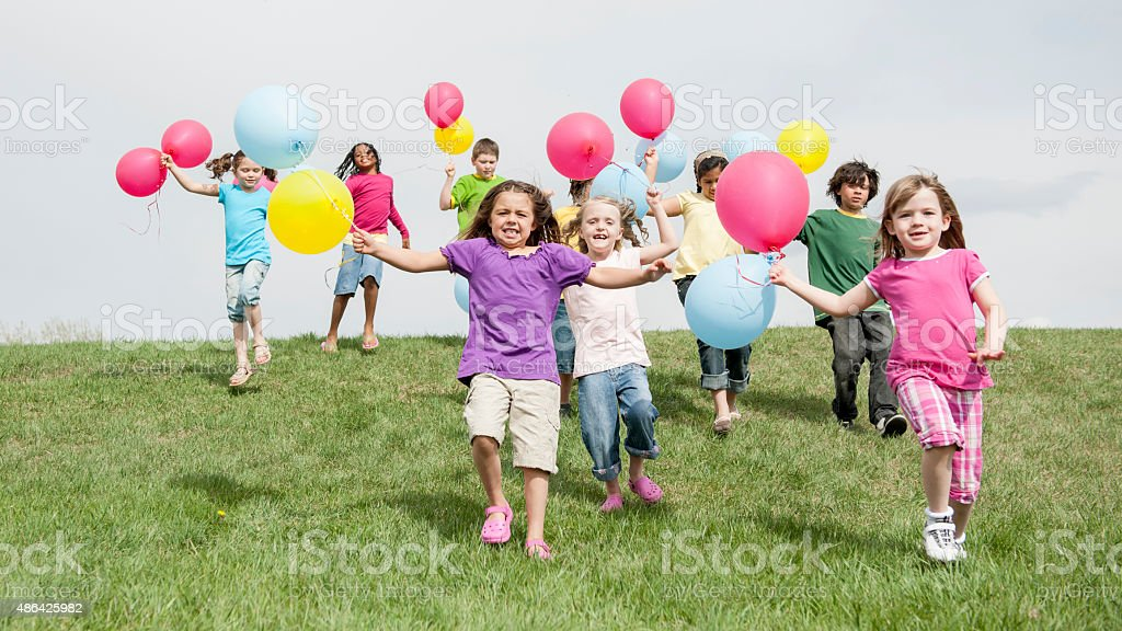 Children Running with Balloons stock photo