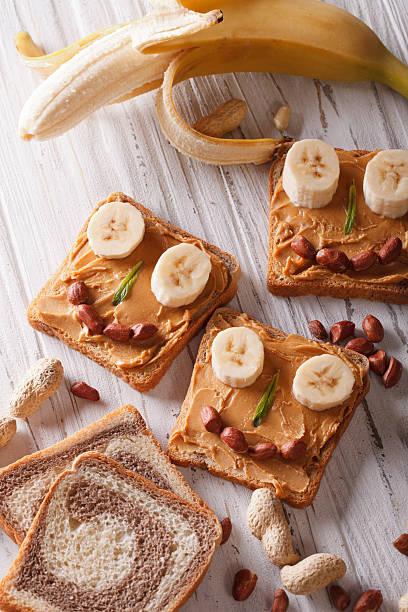children sandwiches with peanut butter and banan top view - peanutbutter bildbanksfoton och bilder