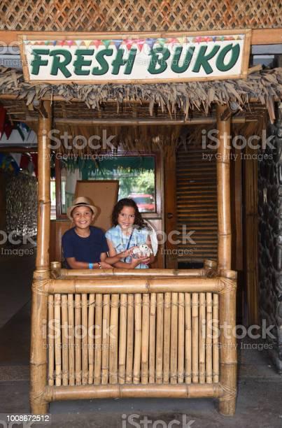 Children selling coconut juice on the street in manila philippines picture id1008672512?b=1&k=6&m=1008672512&s=612x612&h=t05osva6ozxtlaa0b9nzpjr3yuywd rswysj8 4tria=
