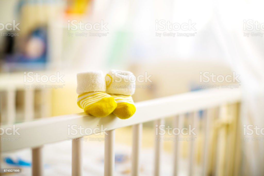 Children  shoes in a cot stock photo