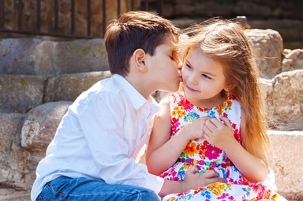 children show love and affection to each other. - little girls little boys kissing love stock photos and pictures