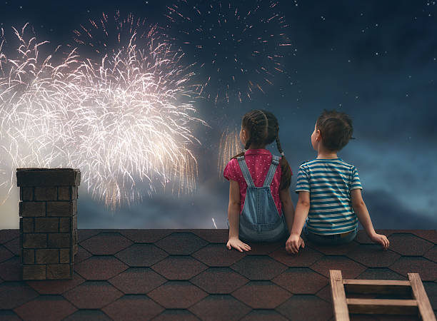 children sit on the roof stock photo