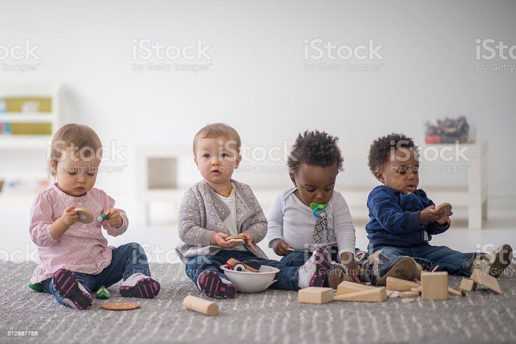 Children Sitting and Playing with Toys stock photo