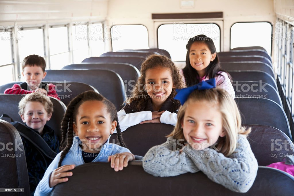 Children sitting inside school bus stock photo