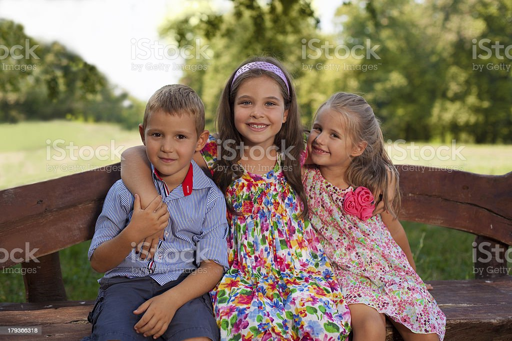 Children sitting on bench royalty-free stock photo