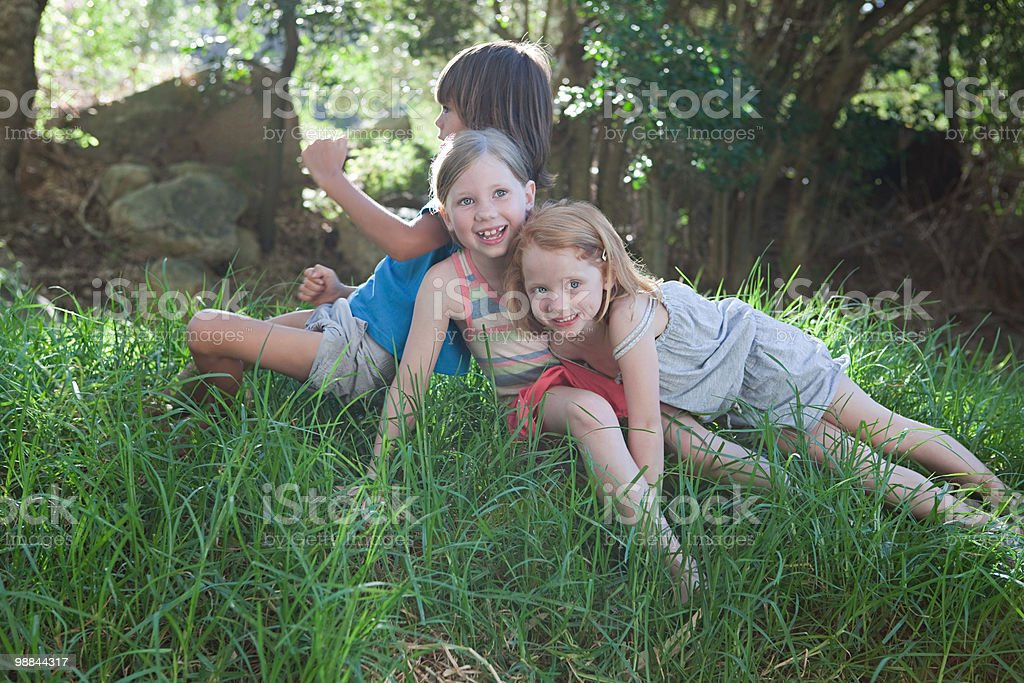 Children sitting on grass royalty free stockfoto