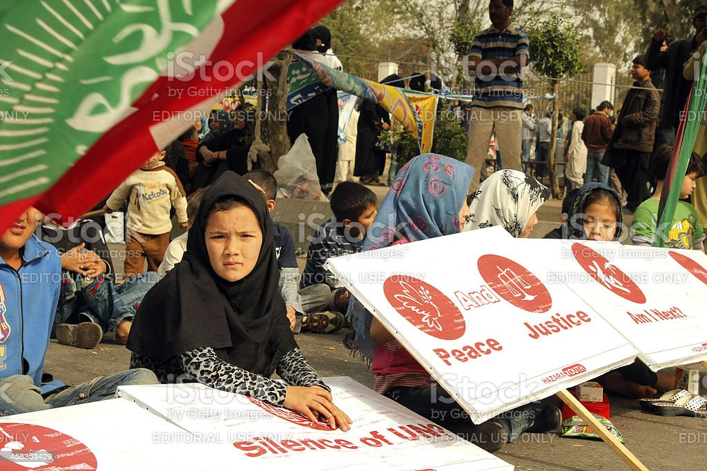 Children Sitting, Protest against Shia Muslims Genocide at Karachi stock photo