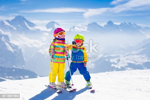 istock Children skiing in the mountains 611897054