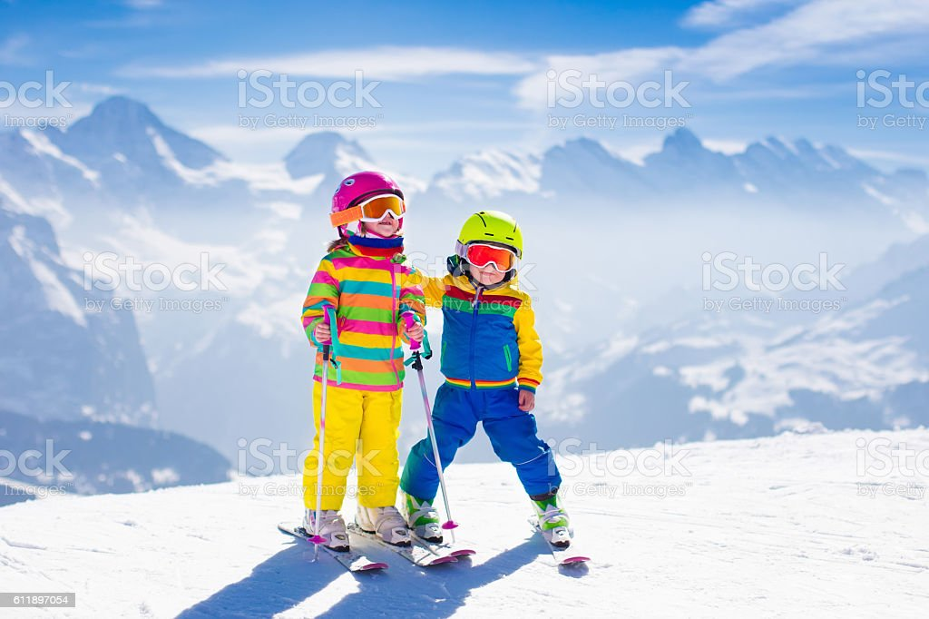 Children skiing in the mountains stock photo