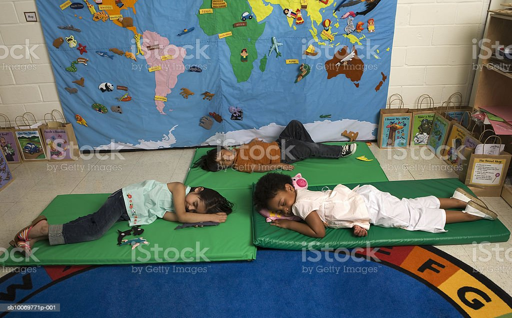 Children (2-5) sleeping in classroom royalty-free stock photo
