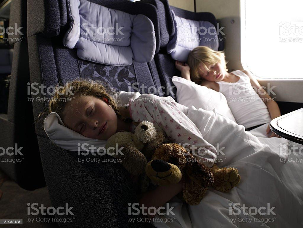 Children sleeping on train royalty-free stock photo