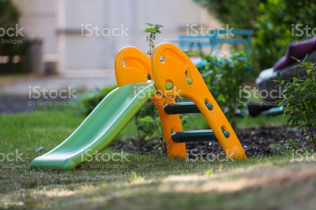 Children slides in the garden stock photo