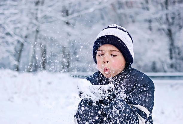 Children snow wishes stock photo